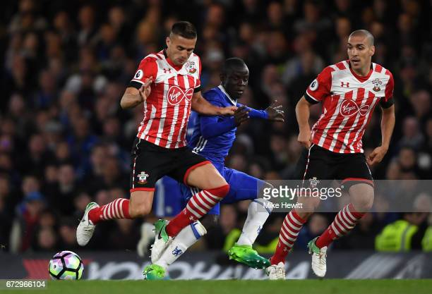 Golo Kante of Chelsea battles with Dusan Tadic and Oriol Romeu of Southampton during the Premier League match between Chelsea and Southampton at...