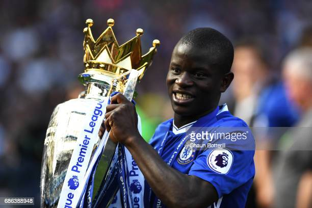 Golo Kante of Chelsea celebrates with the Premier League Trophy after the Premier League match between Chelsea and Sunderland at Stamford Bridge on...