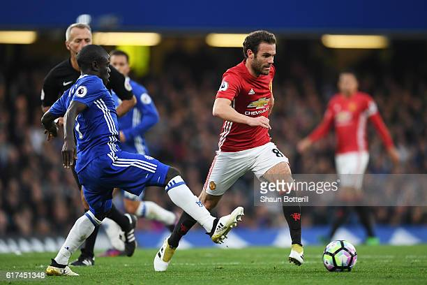 Golo Kante of Chelsea closes down Juan Mata of Manchester United during the Premier League match between Chelsea and Manchester United at Stamford...