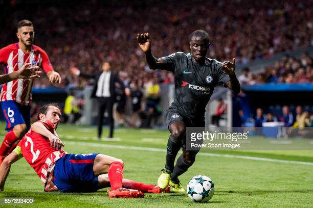 Golo Kante of Chelsea FC fights for the ball with Diego Roberto Godin Leal of Atletico de Madrid during the UEFA Champions League 201718 match...