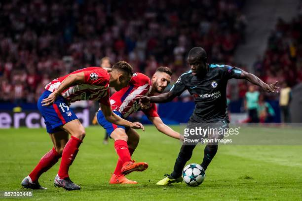 Golo Kante of Chelsea FC fights for the ball with Lucas Hernandez and Jorge Resurreccion Merodio Koke of Atletico de Madrid during the UEFA Champions...