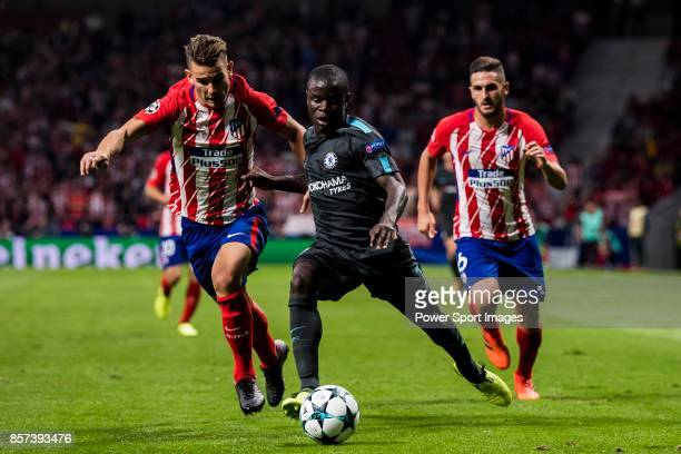 Golo Kante of Chelsea FC fights for the ball with Lucas Hernandez of Atletico de Madrid during the UEFA Champions League 201718 match between...