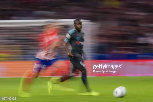 Golo Kante of Chelsea FC is followed by Angel Correa of Atletico de Madrid during the UEFA Champions League 201718 match between Atletico de Madrid...