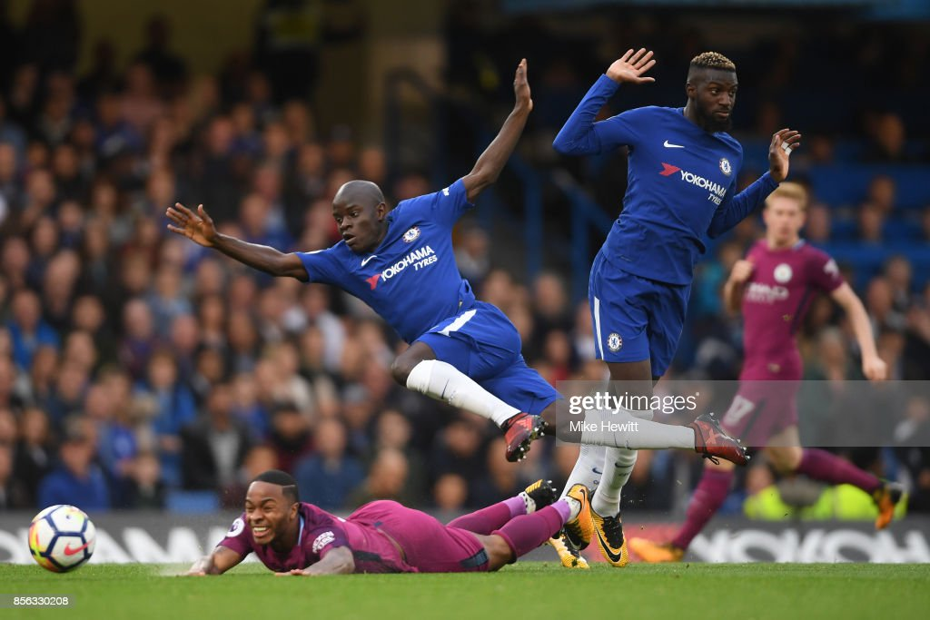 N'Golo Kante of Chelsea flies over the top of Raheem Sterling of Manchester City during the Premier League match between Chelsea and Manchester City at Stamford Bridge on September 30, 2017 in London, England.