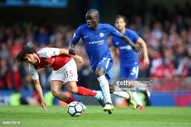 Golo Kante of Chelsea gets away from Mohamed Elneny of Arsenal during the Premier League match between Chelsea and Arsenal at Stamford Bridge on...