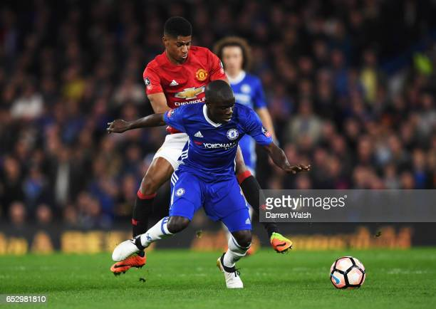 Golo Kante of Chelsea holds off Marcus Rashford of Manchester United during The Emirates FA Cup QuarterFinal match between Chelsea and Manchester...