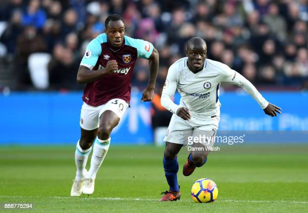 Golo Kante of Chelsea is challenged by Michail Antonio of West Ham United during the Premier League match between West Ham United and Chelsea at...