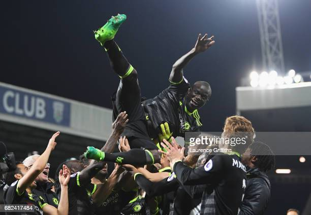 Golo Kante of Chelsea is chucked in the air by team mates while celebrating winning the leauge title after the Premier League match between West...