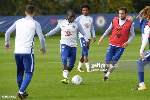 Golo Kante of Chelsea is closed down by Cesc Fabregas of Chelsea during a training session at Chelsea Training Ground on September 19 2017 in Cobham...