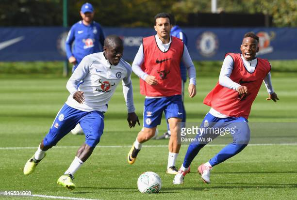 N'Golo Kante of Chelsea is pursued by Charly Musonda of Chelsea during a training session at Chelsea Training Ground on September 19 2017 in Cobham...