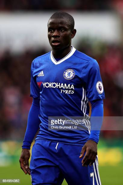 Golo Kante of Chelsea looks on during the Premier League match between Stoke City and Chelsea at Bet365 Stadium on March 18 2017 in Stoke on Trent...