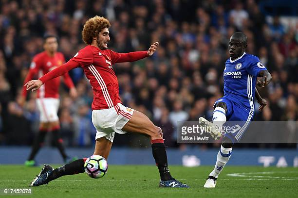Golo Kante of Chelsea passes the ball past Marouane Fellaini of Manchester United during the Premier League match between Chelsea and Manchester...