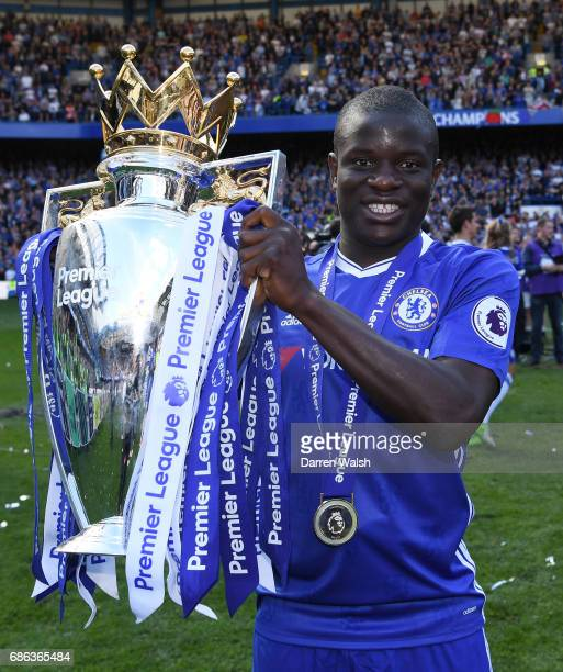 Golo Kante of Chelsea poses with the Premier League Trophy after the Premier League match between Chelsea and Sunderland at Stamford Bridge on May 21...