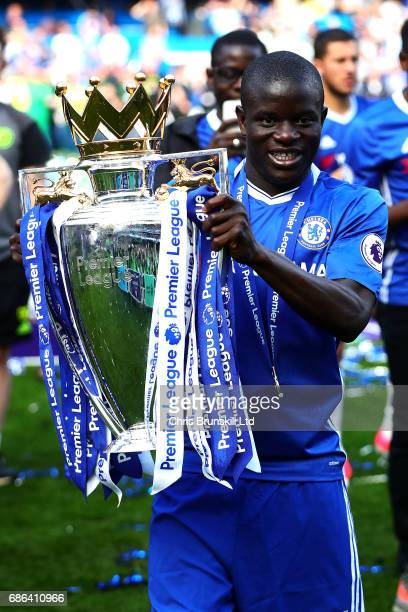 Golo Kante of Chelsea poses with the Premier League trophy following the Premier League match between Chelsea and Sunderland at Stamford Bridge on...