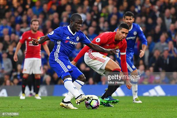 Golo Kante of Chelsea scores his sides fourth goal during the Premier League match between Chelsea and Manchester United at Stamford Bridge on...