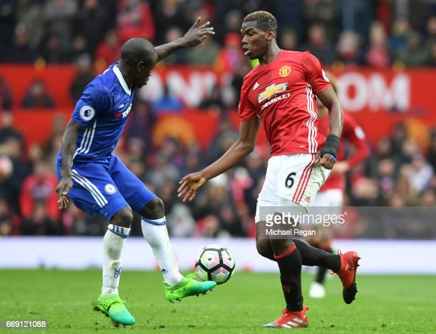 Golo Kante of Chelsea tackles Paul Pogba of Manchester United during the Premier League match between Manchester United and Chelsea at Old Trafford...