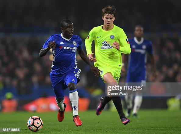 Golo Kante of Chelsea takes the ball away from Andrew Hughes of Peterborough United during The Emirates FA Cup Third Round match between Chelsea and...