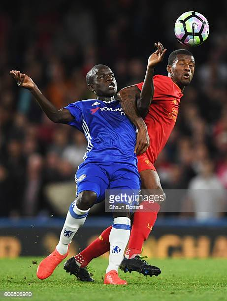 Golo Kante of Chelsea tangles with Georginio Wijnaldum of Liverpool during the Premier League match between Chelsea and Liverpool at Stamford Bridge...