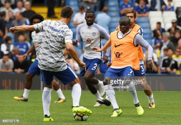 Golo Kante of Chelsea warms up prior to the Premier League match between Chelsea and Burnley at Stamford Bridge on August 12 2017 in London England