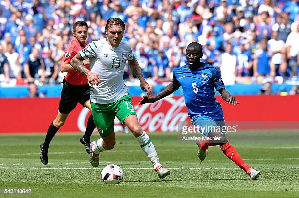Golo Kante of France and Jeff Hendrick of The Republic of Ireland fight for the ball during the UEFA Euro 2016 round of 16 match between France and...