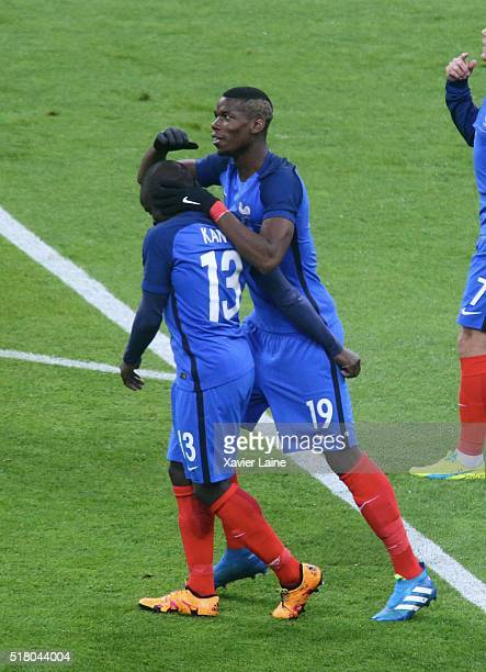 Golo Kante of France celebrate his goal with Paul Pogba during the International Friendly games between France and Russia at Stade de France on march...