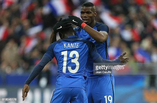 Golo Kante of France celebrates his goal with Paul Pogba of France during the international friendly match between France and Russia at Stade de...