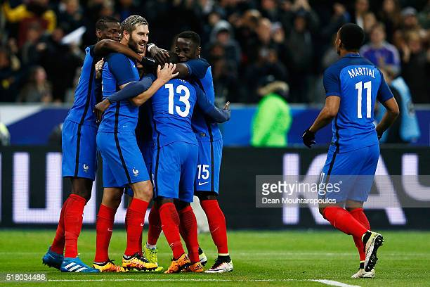 Golo Kante of France celebrates scoring his teams first goal of the game with teammates AndrePierre Gignac and Antoine Griezmann during the...