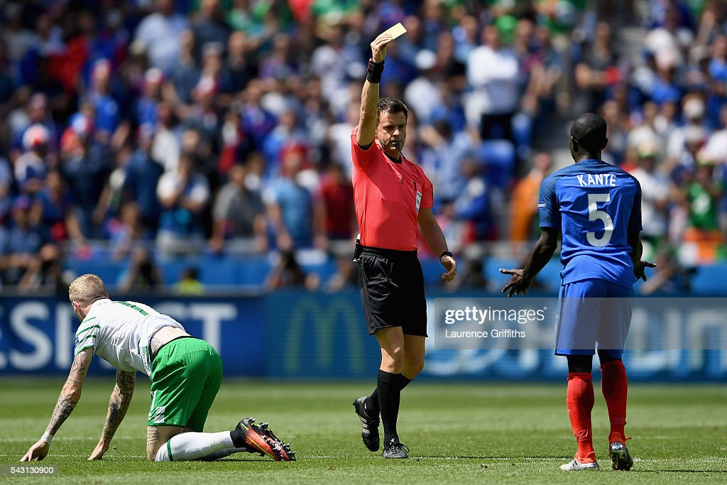 N'Golo Kante of France is shown a yellow card by referee <a gi-track='captionPersonalityLinkClicked' href=/galleries/search?phrase=Nicola+Rizzoli&family=editorial&specificpeople=4238940 ng-click='$event.stopPropagation()'>Nicola Rizzoli</a> after fouling <a gi-track='captionPersonalityLinkClicked' href=/galleries/search?phrase=James+McClean&family=editorial&specificpeople=3699424 ng-click='$event.stopPropagation()'>James McClean</a> of Republic of Ireland during the UEFA EURO 2016 round of 16 match between France and Republic of Ireland at Stade des Lumieres on June 26, 2016 in Lyon, France.