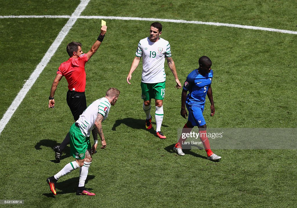 N'Golo Kante (1st R) of France is shown a yellow card by referee <a gi-track='captionPersonalityLinkClicked' href=/galleries/search?phrase=Nicola+Rizzoli&family=editorial&specificpeople=4238940 ng-click='$event.stopPropagation()'>Nicola Rizzoli</a> (1st L) after fouling <a gi-track='captionPersonalityLinkClicked' href=/galleries/search?phrase=James+McClean&family=editorial&specificpeople=3699424 ng-click='$event.stopPropagation()'>James McClean</a> (2nd L) of Republic of Ireland during the UEFA EURO 2016 round of 16 match between France and Republic of Ireland at Stade des Lumieres on June 26, 2016 in Lyon, France.