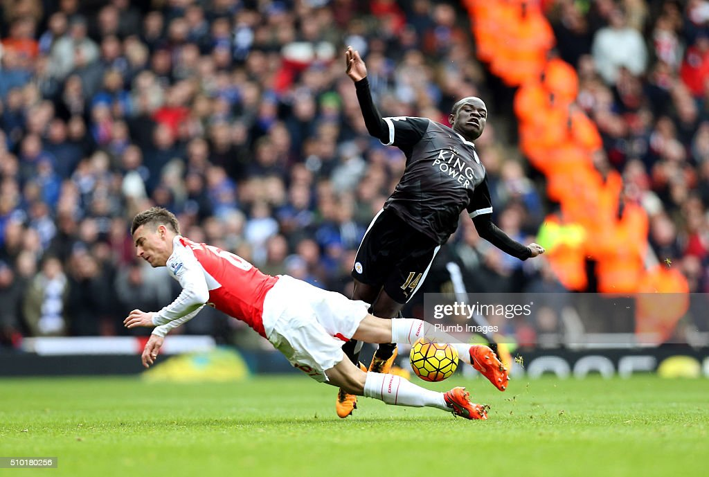 N'Golo Kante of Leicester City in action with Laurent Koscielny of Arsenal during the Premier League match between Arsenal and Leicester City at Emirates Stadium on February 14, 2016 in London, United Kingdom.