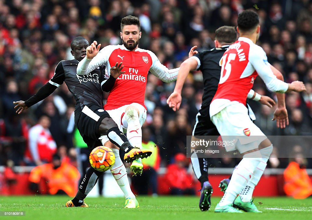 N'Golo Kante of Leicester City in action with Olivier Giroud of Arsenal during the Premier League match between Arsenal and Leicester City at Emirates Stadium on February 14, 2016 in London, United Kingdom.