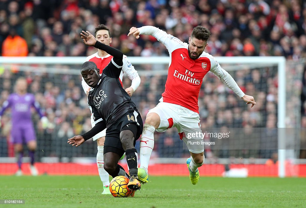 N'Golo Kante of Leicester City in action with Olivier Giroud of Arsenal during the Barclays Premier League match between Arsenal and Leicester City at Emirates Stadium on February 14, 2016 in London, United Kingdom.