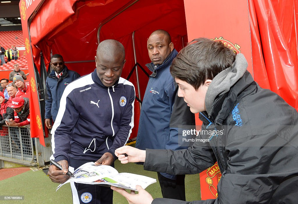 N'Golo Kante of Leicester City signs autographs at Old Trafford ahead of the Premier League match between Manchester United and Leicester City at Old Trafford on May 01, 2016 in Manchester, United Kingdom.