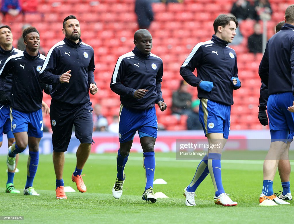 N'Golo Kante of Leicester City warms up at Old Trafford ahead of the Premier League match between Manchester United and Leicester City at Old Trafford on May 01, 2016 in Manchester, United Kingdom.