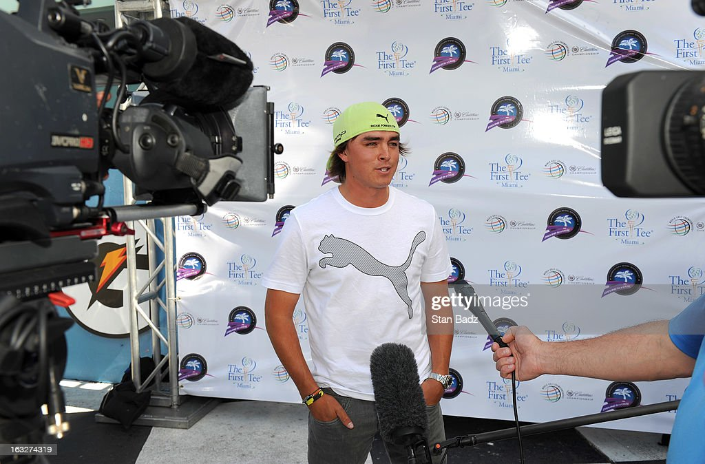 Golpher Rickie Fowler speaks to the media after driving a variety of Cadillac vehicles at the Homestead-Miami Speedway as part of The Cadillac Driving Experience event held for PGA TOUR professionals during the World Golf Championships-Cadillac Championship at TPC Blue Monster at Doral on March 6, 2013 in Miami, Florida.