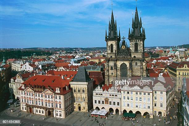 GoltzKinsky palace 17551765 on the left and the Church of Our Lady before Tyn 13651511 Old Town Square in Prague Czech Republic
