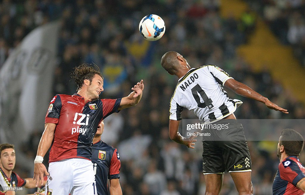 Gomes Pereira Naldo (R) of Udinese Calcio competes with <a gi-track='captionPersonalityLinkClicked' href=/galleries/search?phrase=Alberto+Gilardino&family=editorial&specificpeople=215491 ng-click='$event.stopPropagation()'>Alberto Gilardino</a> of Genoa CFC during the Serie A match between Udinese Calcio and Genoa CFC at Stadio Friuli on September 24, 2013 in Udine, Italy.