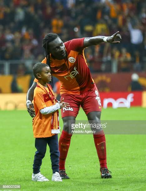 Gomis of Galatasaray celebrates with his son after winning the Turkish Super Lig soccer match between Galatasaray and Kardemir Karabukspor at Turk...