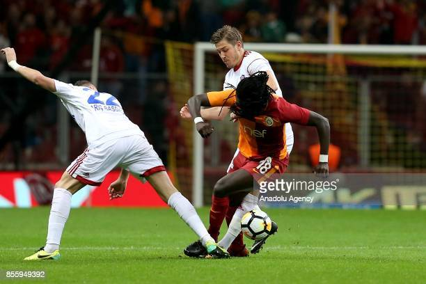 Gomis of Galatasaray in action against Baris Basdas of Kardemir Karabukspor during the Turkish Super Lig soccer match between Galatasaray and...