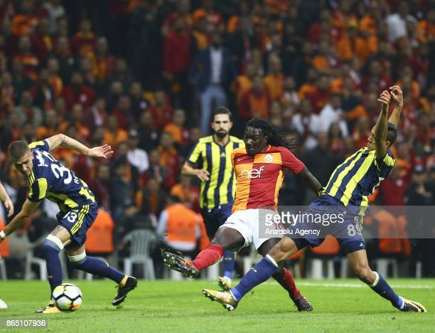 Gomis of Galatasaray in action against Josef De Souza of Fenerbahce during a Turkish Super Lig match between Galatasaray and Fenerbahce at Ali Sami...