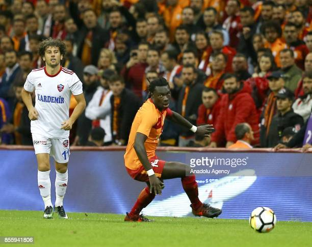 Gomis of Galatasaray in action against Kerim Zengin of Kardemir Karabukspor during the Turkish Super Lig soccer match between Galatasaray and...