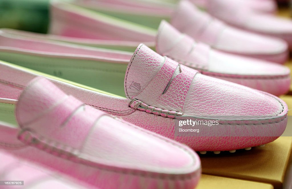 Gommino leather moccasin loafers sit on boxes during the manufacture of Tod's SpA luxury shoes inside the workshop at the company's headquarters in...