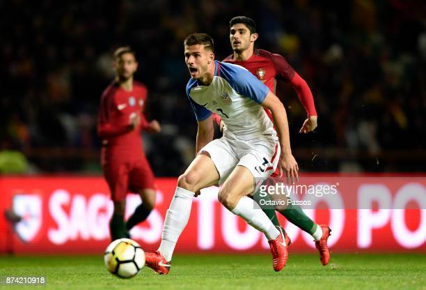 Gonçalo Guedes of Portugal competes for the ball with Matt Miazga during the International Friendly match between Portugal and USA at Estadio...
