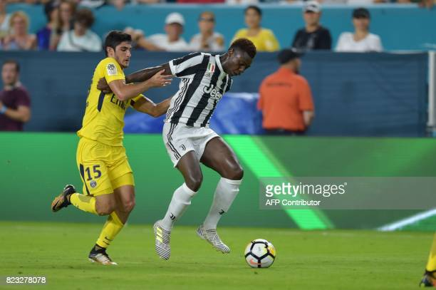 Goncalo Guedes of Paris SaintGermain and Moise Kean of Juventus vie for the ball during their International Champions Cup football match on July 26...