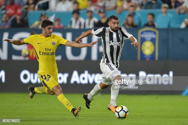 Goncalo Guedes of Paris SaintGermain and Tomas Rincon of Juventus vie for the ball during their International Champions Cup football match on July 26...
