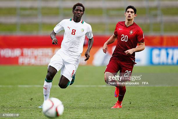 Goncalo Guedes of Portugal and Sidy Sarr of Senegal run for the ball during the FIFA U20 World Cup New Zealand 2015 Group C match between Portugal...