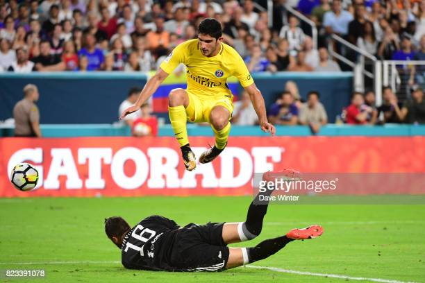 Goncalo Guedes of PSG hurdles Carlo Pinsoglio of Juventus during the International Champions Cup match between Paris Saint Germain and Juventus Turin...