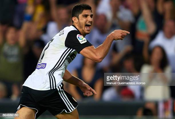 Goncalo Guedes of Valencia celebrates scoring his team's first goal during the La Liga match between Valencia and Sevilla at Estadio Mestalla on...