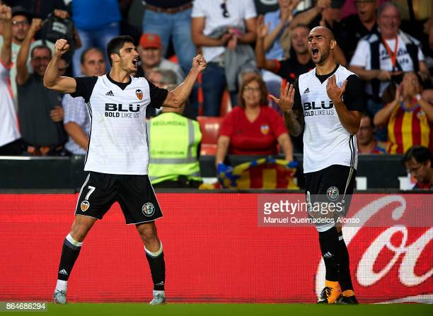 Goncalo Guedes of Valencia celebrates scoring his team's first goal with his teammate Simone Zaza during the La Liga match between Valencia and...