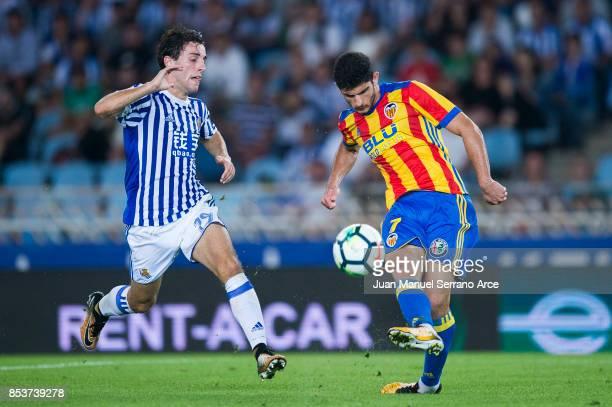 Goncalo Guedes of Valencia CF duels for the ball with Alvaro Odriozola of Real Sociedad during the La Liga match between Real Sociedad de Futbol and...